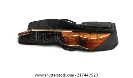 Acoustic Guitar in Black Carry Bag On White Background - stock photo