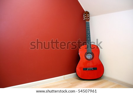 acoustic guitar in room corner - stock photo