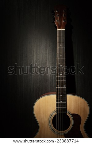 Acoustic guitar in the dark - stock photo