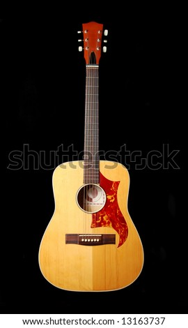 acoustic guitar isolated on black background