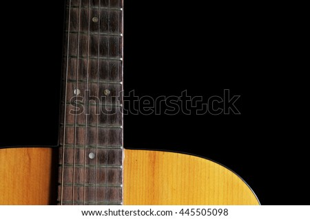 acoustic guitar isolated with black background, acoustic guitar close-up