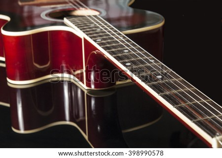 Acoustic guitar on black background
