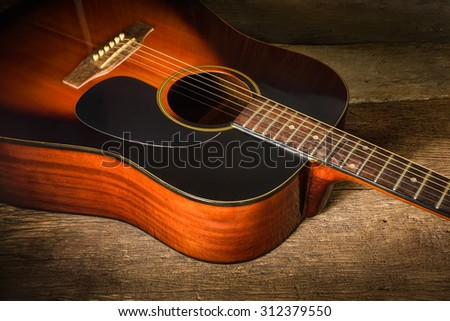 Acoustic guitar on old wood background