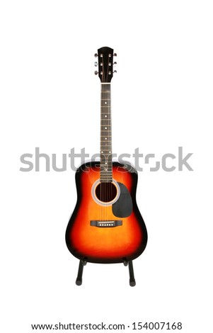 Acoustic guitar on stand isolated on white background - stock photo