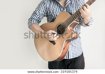 Acoustic Guitar Playing. Men Playing Acoustic Guitar - stock photo