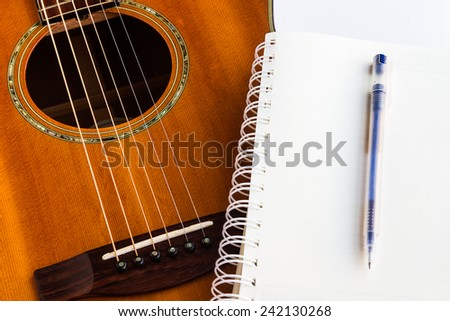 Acoustic guitar sounds great and is a popular instrument. - stock photo