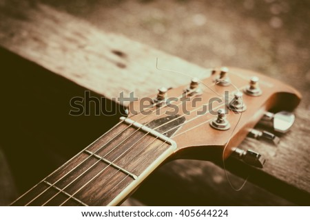 Acoustic guitar. Strings. background, vintage tone - stock photo