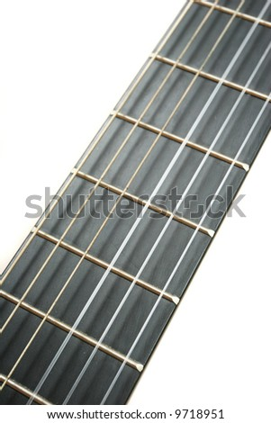 Acoustic guitar strings close up on white background - stock photo