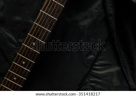 Acoustic guitar with a denim jacket