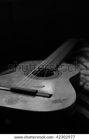 Acoustic spanish guitar with a broken string. - stock photo