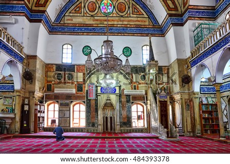 ACRE, ISRAEL- APRIL 05, 2015: Al-Jazzar Mosque (1781) .Ottoman architecture style,the third largest mosque in Israel.Famous open tourist site of Old town of Acre which is UNESCO World Heritage