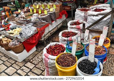 ACRE,ISRAEL - APRIL 05, 2015: East Arab market of old City of Acre (Akko) offers variety of the middle east products and traditional spices,herbs and olives of the Mediterranean. - stock photo