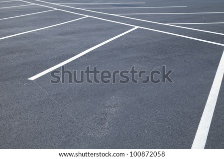 Acres of empty parking spaces - stock photo