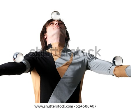 Acrobat with a glass marble on the white background