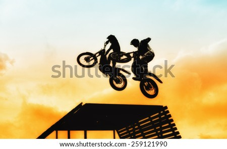 acrobatic jump with motorbike - stock photo