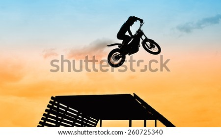 acrobatic jump with motorbike - stock photo