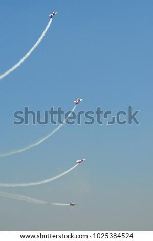 Acrobatric airplanes evolutions during airshow Turin Italy circa June 2016