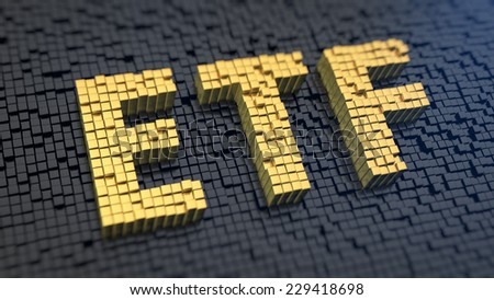 Acronym 'ETF' of the yellow square pixels on a black matrix background. Stocks fund concept. - stock photo