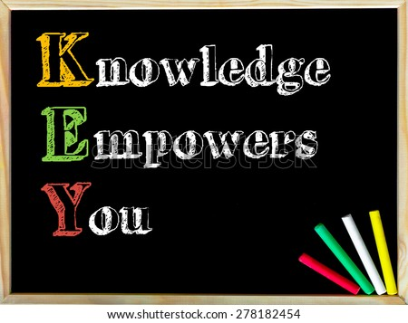 Acronym KEY as KNOWLEDGE EMPOWERS YOU. Written note on wooden frame blackboard, colored chalk in the corner. Motivational Concept image - stock photo