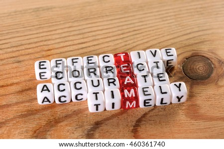 acronym of  TEAM  red and  dices on wood