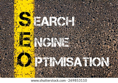 Acronym SEO - Search Engine Optimisation. Business Conceptual image with yellow paint line on the road over asphalt stone background. - stock photo