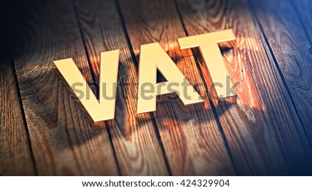 "Acronym ""VAT"" is lined with gold letters on wooden planks. 3D illustration image"