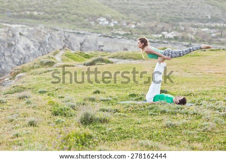 Acroyoga - Balancing on Feet - stock photo