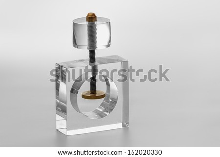 Acrylic objecto to broke things, specially walnuts, nut. Isolated transparent object with white background. - stock photo
