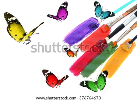 Acrylic paints with art brushes and colorful beautiful butterflies. Nature inspiration. Nature and art abstract  with copy space. Isolated on a white background  - stock photo