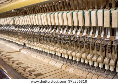 Action mechanics close up inside of an upright piano - stock photo