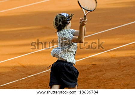 action shot of child playing tennis - stock photo