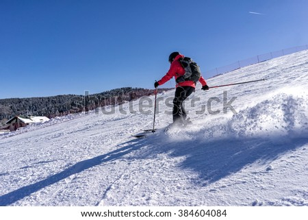 Action shot of female skier on italian slopes. - stock photo