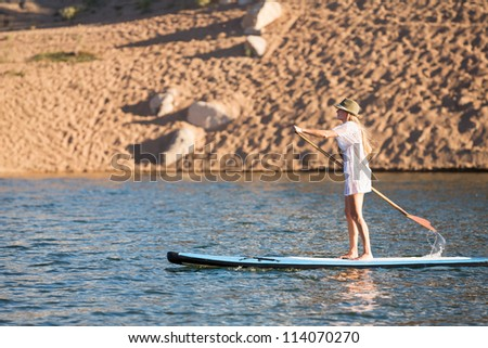 Action Shot of Woman on Paddle Board