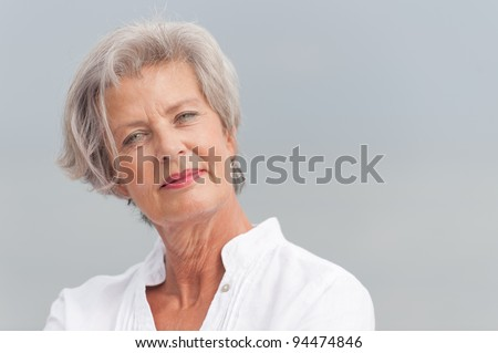 Active and happy senior woman - stock photo