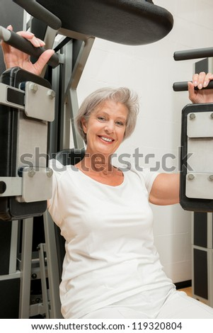 Active and smiling senior in a gym