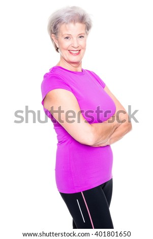 Active and sporty senior woman in front of white background - stock photo