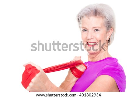 Active and sporty senior woman in front of white background
