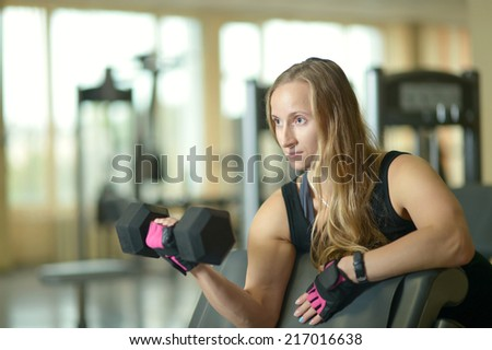 Active beautiful young woman workout at gym - stock photo