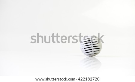 Active carbon charcoal ball odour neutralizer. Isolated on white background. Slightly de-focused and close-up shot. Copy space.
