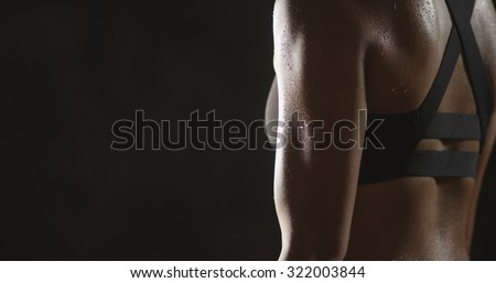 Active Chinese woman lifting dumbbells weights and sweating - stock photo