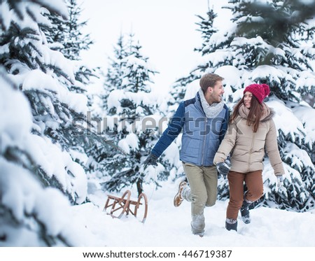 Active couple at a winter forest