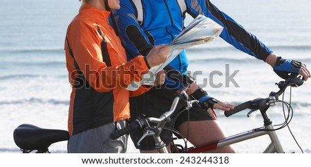 Active couple on a bike ride in the countryside - stock photo