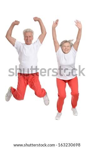 Active elderly couple exercising isolated on white background - stock photo