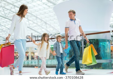 Active families with a children in a store