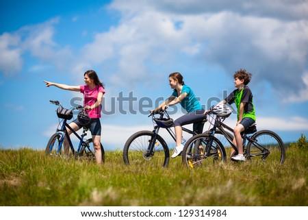 Active family biking - stock photo