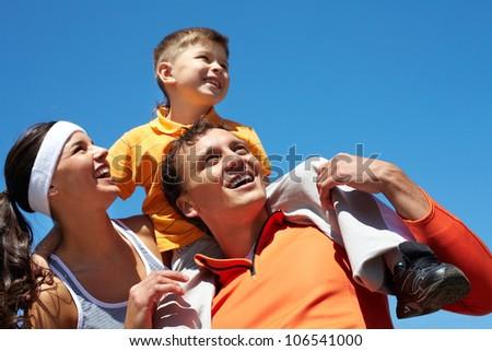 Active family enjoying hot sunny days outdoors - stock photo