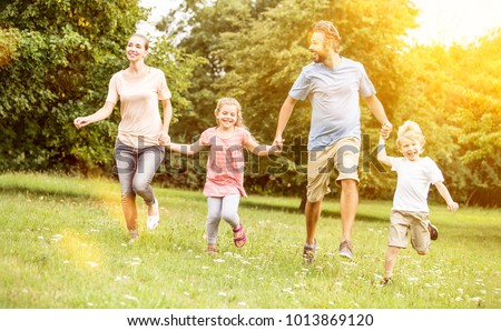 Active family with children making sport in the nature