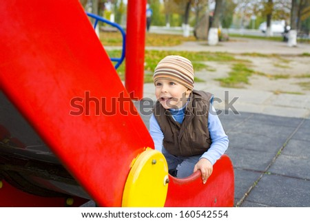 Active four-year-old child playing at a playground - stock photo