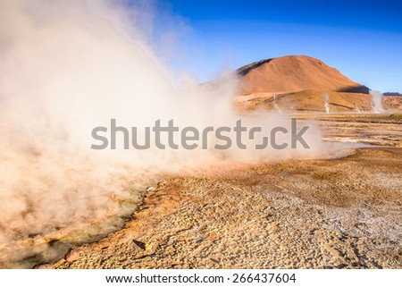 Active geysers comes out of the ground, Atacama desert, Chile - stock photo