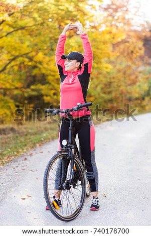 Active girl with bicycle in nature